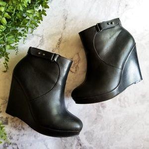 Torrid | Black Faux Leather Wedge Ankle Booties